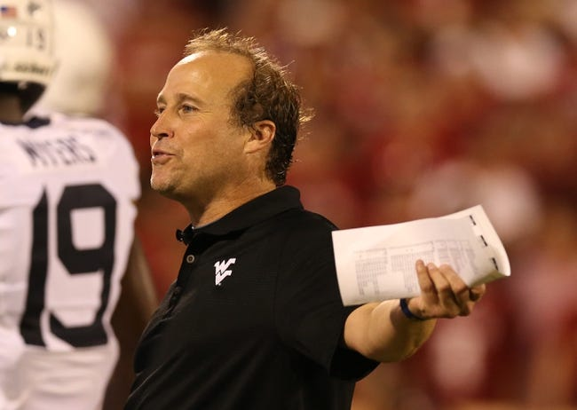 Sep 7, 2013; Norman, OK, USA; West Virginia Mountaineers head coach Dana Holgorsen during the game against the Oklahoma Sooners at Gaylord Family - Oklahoma Memorial Stadium. The Oklahoma Sooners beat the West Virginia Mountaineers 16-7. Mandatory Credit: Matthew Emmons-USA TODAY Sports