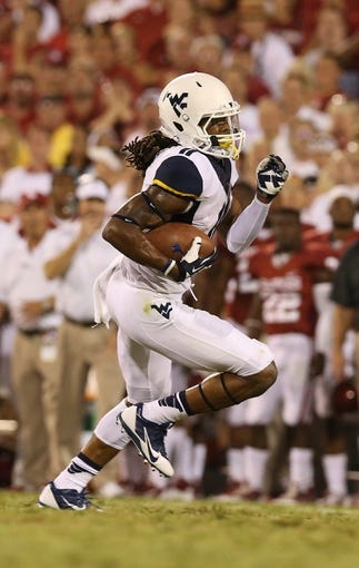 Sep 7, 2013; Norman, OK, USA; West Virginia Mountaineers receiver Kevin White (11) runs after a catch against the Oklahoma Sooners at Gaylord Family - Oklahoma Memorial Stadium. The Oklahoma Sooners beat the West Virginia Mountaineers 16-7. Mandatory Credit: Matthew Emmons-USA TODAY Sports