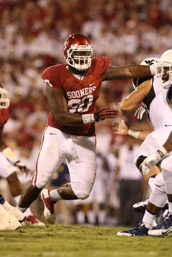 Sep 7, 2013; Norman, OK, USA; Oklahoma Sooners nose tackle Jordan Phillips (80) in action against the West Virginia Mountaineers at Gaylord Family - Oklahoma Memorial Stadium. Mandatory Credit: Matthew Emmons-USA TODAY Sports