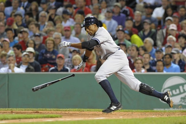 Sep 13, 2013; Boston, MA, USA; New York Yankees right fielder Curtis Granderson (14) bunts the ball during the third inning against the Boston Red Sox at Fenway Park. Mandatory Credit: Bob DeChiara-USA TODAY Sports