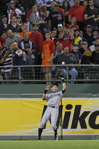 Sep 13, 2013; Boston, MA, USA; New York Yankees right fielder Ichiro Suzuki (31) makes a catch during the fourth inning against the Boston Red Sox at Fenway Park. Mandatory Credit: Bob DeChiara-USA TODAY Sports