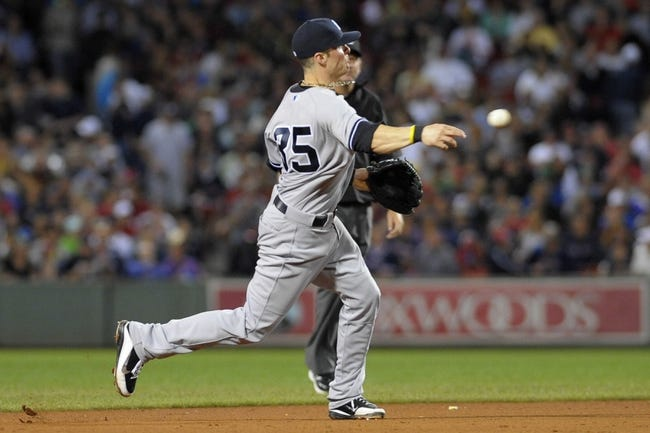 Sep 13, 2013; Boston, MA, USA; New York Yankees shortstop Brendan Ryan (35) throws to first base during the fifth inning against the Boston Red Sox at Fenway Park. Mandatory Credit: Bob DeChiara-USA TODAY Sports