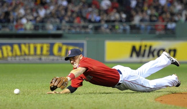 Sep 13, 2013; Boston, MA, USA; Boston Red Sox shortstop Stephen Drew (7) dives for a ground ball during the seventh inning against the New York Yankees at Fenway Park. Mandatory Credit: Bob DeChiara-USA TODAY Sports