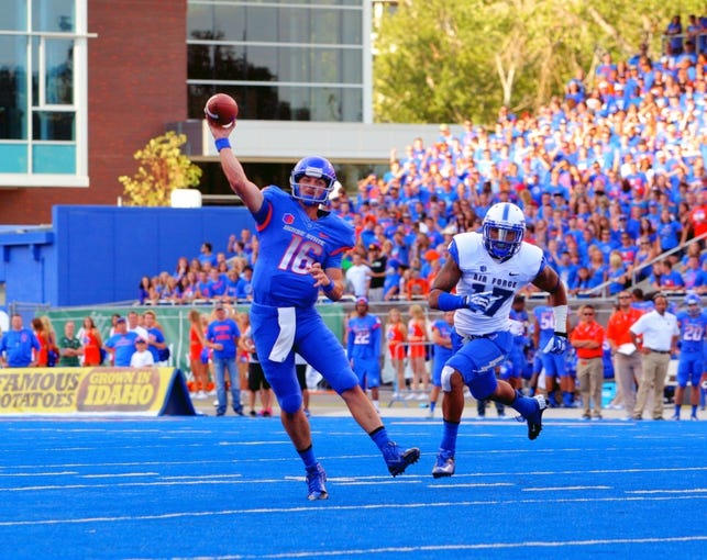 Sep 13, 2013; Boise, ID, USA; Boise State Broncos quarterback Joe Southwick (16) throws a touchdown pass to wide receiver Kirby Moore (34) during the first half against the Air Force Falcons at Bronco Stadium. Mandatory Credit: Brian Losness-USA TODAY Sports
