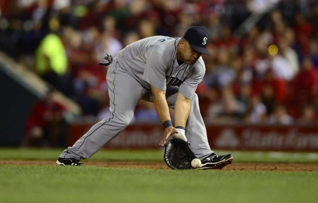 Sep 13, 2013; St. Louis, MO, USA; Seattle Mariners designated hitter Kendrys Morales (8) fields a ground ball hit by St. Louis Cardinals first baseman Matt Adams (not pictured) during the second inning at Busch Stadium. Mandatory Credit: Jeff Curry-USA TODAY Sports