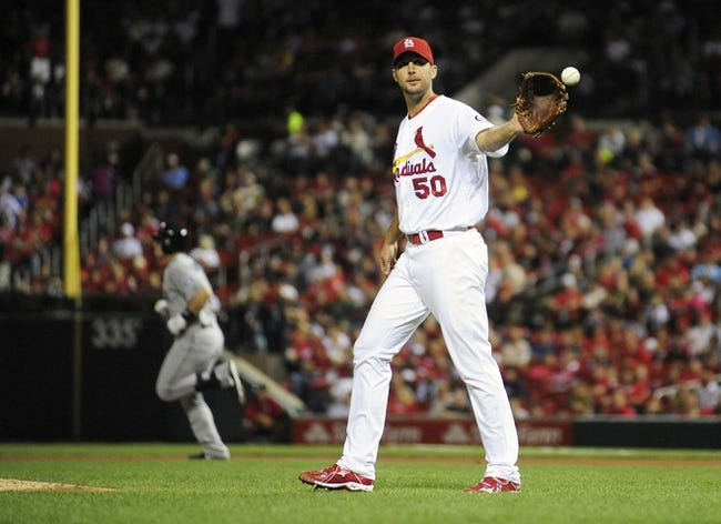 Sep 13, 2013; St. Louis, MO, USA; St. Louis Cardinals starting pitcher Adam Wainwright (50) receives a new baseball after giving up a solo home run to Seattle Mariners catcher Mike Zunino (3) during the fifth inning at Busch Stadium. Mandatory Credit: Jeff Curry-USA TODAY Sports
