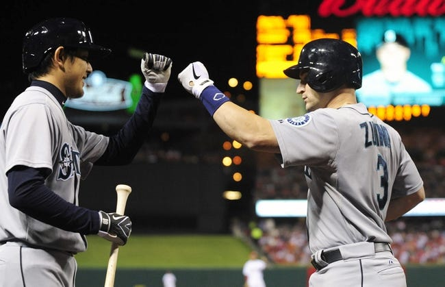 Sep 13, 2013; St. Louis, MO, USA; Seattle Mariners catcher Mike Zunino (3) is congratulated by starting pitcher Hisashi Iwakuma (18) after hitting a solo home run off of St. Louis Cardinals starting pitcher Adam Wainwright (not pictured) during the fifth inning at Busch Stadium. Mandatory Credit: Jeff Curry-USA TODAY Sports