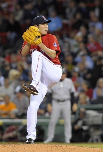 Sep 13, 2013; Boston, MA, USA; Boston Red Sox relief pitcher Koji Uehara (19) pitches during the ninth inning against the New York Yankees at Fenway Park. Mandatory Credit: Bob DeChiara-USA TODAY Sports