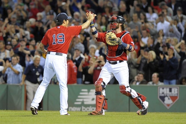 Sep 13, 2013; Boston, MA, USA; Boston Red Sox relief pitcher Koji Uehara (19) high fives catcher Jarrod Saltalamacchia (39) after defeating the New York Yankees at Fenway Park. Mandatory Credit: Bob DeChiara-USA TODAY Sports