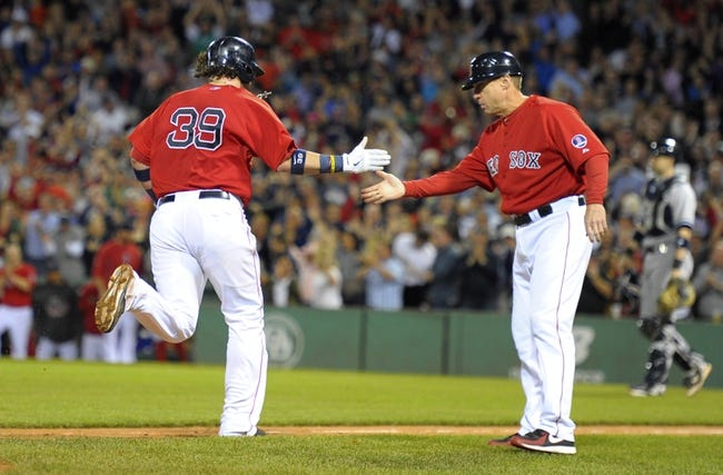 Sep 13, 2013; Boston, MA, USA; Boston Red Sox catcher Jarrod Saltalamacchia (39) is greeted by third base coach Brian Butterfield (13) after hitting a grand slam during the seventh inning against the New York Yankees at Fenway Park. Mandatory Credit: Bob DeChiara-USA TODAY Sports
