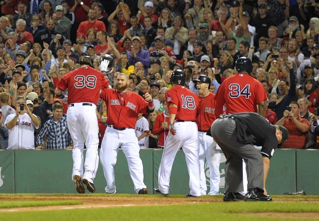 Sep 13, 2013; Boston, MA, USA; Boston Red Sox catcher Jarrod Saltalamacchia (39) jumps on home plate after hitting a grand slam during the seventh inning against the New York Yankees at Fenway Park. Mandatory Credit: Bob DeChiara-USA TODAY Sports