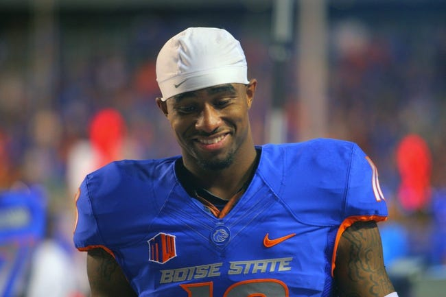 Sep 13, 2013; Boise, ID, USA; Boise State Broncos wide receiver Aaron Burks (18) during the second half against the Air Force Falcons at Bronco Stadium. Boise State defeated the Air Force 42-20. Mandatory Credit: Brian Losness-USA TODAY Sports