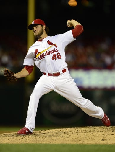 Sep 13, 2013; St. Louis, MO, USA; St. Louis Cardinals relief pitcher Kevin Siegrist (46) throws to a Seattle Mariners batter during the tenth inning at Busch Stadium. St. Louis defeated Seattle 2-1 in 10 innings. Mandatory Credit: Jeff Curry-USA TODAY Sports