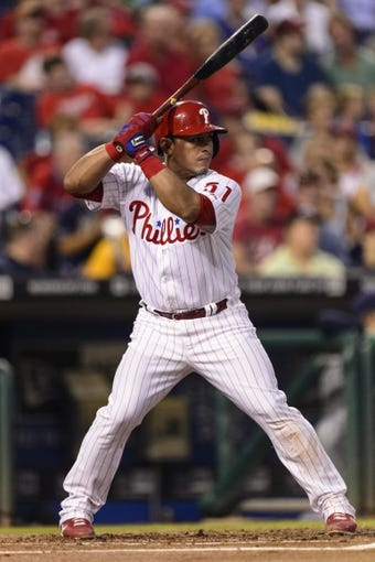 Sep 11, 2013; Philadelphia, PA, USA; Philadelphia Phillies catcher Carlos Ruiz (51) during an at bat during the first inning against the San Diego Padres at Citizens Bank Park. The Phillies defeated the Padres 4-2. Mandatory Credit: Howard Smith-USA TODAY Sports