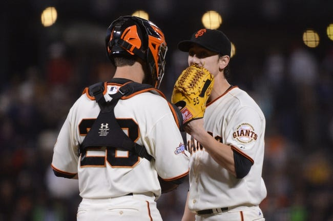 September 9, 2013; San Francisco, CA, USA; San Francisco Giants starting pitcher Tim Lincecum (55, right) talks to catcher Buster Posey (28, left) during the sixth inning against the Colorado Rockies at AT&T Park. The Giants defeated the Rockies 3-2 in 10 innings. Mandatory Credit: Kyle Terada-USA TODAY Sports