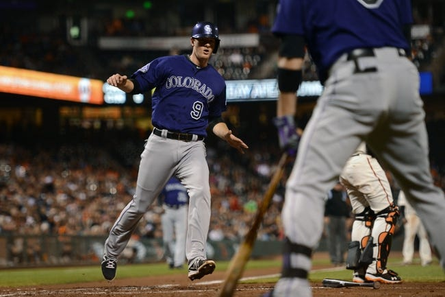 September 9, 2013; San Francisco, CA, USA; Colorado Rockies second baseman D.J. LeMahieu (9) scores during the third inning against the San Francisco Giants at AT&T Park. The Giants defeated the Rockies 3-2 in 10 innings. Mandatory Credit: Kyle Terada-USA TODAY Sports
