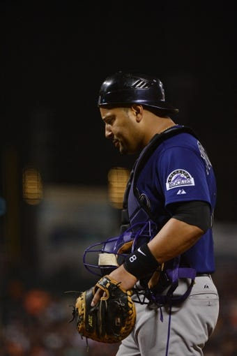 September 9, 2013; San Francisco, CA, USA; Colorado Rockies catcher Yorvit Torrealba (8) during the fourth inning against the San Francisco Giants at AT&T Park. The Giants defeated the Rockies 3-2 in 10 innings. Mandatory Credit: Kyle Terada-USA TODAY Sports