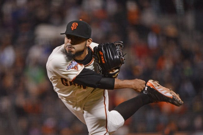 September 9, 2013; San Francisco, CA, USA; San Francisco Giants relief pitcher Sergio Romo (54) delivers a pitch during the ninth inning against the Colorado Rockies at AT&T Park. The Giants defeated the Rockies 3-2 in 10 innings. Mandatory Credit: Kyle Terada-USA TODAY Sports