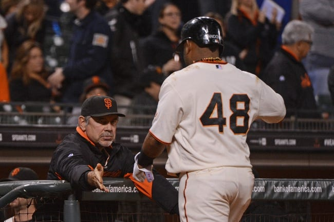 September 9, 2013; San Francisco, CA, USA; San Francisco Giants manager Bruce Bochy (15, left) congratulates third baseman Pablo Sandoval (48) during the ninth inning against the Colorado Rockies at AT&T Park. The Giants defeated the Rockies 3-2 in 10 innings. Mandatory Credit: Kyle Terada-USA TODAY Sports