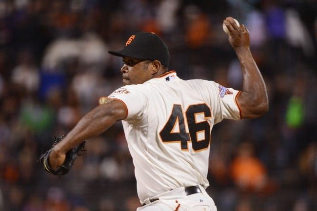 September 9, 2013; San Francisco, CA, USA; San Francisco Giants relief pitcher Santiago Casilla (46) delivers a pitch during the 10th inning against the Colorado Rockies at AT&T Park. The Giants defeated the Rockies 3-2 in 10 innings. Mandatory Credit: Kyle Terada-USA TODAY Sports