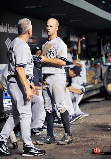 Sep 11, 2013; Baltimore, MD, USA; New York Yankees center fielder Brett Gardner (11) in the dugout during the third inning against the Baltimore Orioles at Oriole Park at Camden Yards. The Yankees defeated the Orioles 5-4. Mandatory Credit: Joy R. Absalon-USA TODAY Sports