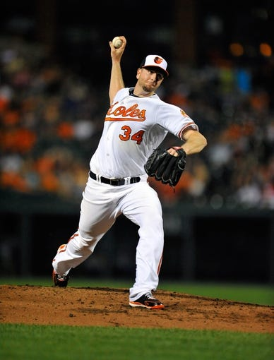 Sep 11, 2013; Baltimore, MD, USA; Baltimore Orioles starting pitcher Scott Feldman (34) throws in the third inning against the New York Yankees at Oriole Park at Camden Yards. The Yankees defeated the Orioles 5-4. Mandatory Credit: Joy R. Absalon-USA TODAY Sports