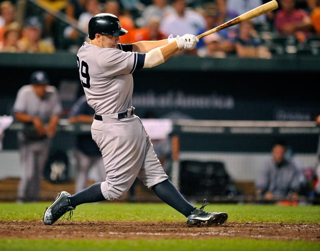 Sep 11, 2013; Baltimore, MD, USA; New York Yankees third baseman Mark Reynolds (39) bats in the ninth inning against the Baltimore Orioles at Oriole Park at Camden Yards. The Yankees defeated the Orioles 5-4. Mandatory Credit: Joy R. Absalon-USA TODAY Sports