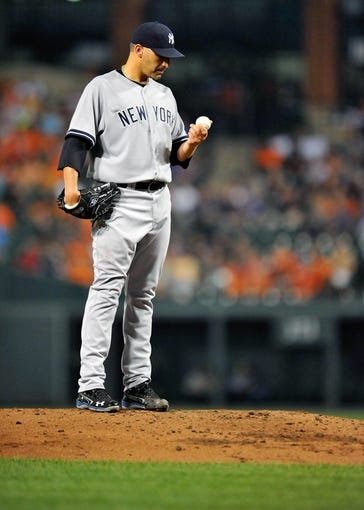 Sep 11, 2013; Baltimore, MD, USA; New York Yankees starting pitcher Andy Pettitte (46) throws in the third inning against the Baltimore Orioles at Oriole Park at Camden Yards. The Yankees defeated the Orioles 5-4. Mandatory Credit: Joy R. Absalon-USA TODAY Sports