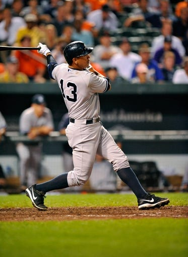 Sep 11, 2013; Baltimore, MD, USA; New York Yankees designated hitter Alex Rodriguez (13) bats in the eighth inning against the Baltimore Orioles at Oriole Park at Camden Yards. The Yankees defeated the Orioles 5-4. Mandatory Credit: Joy R. Absalon-USA TODAY Sports