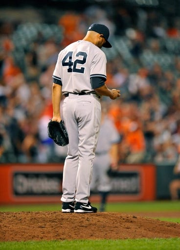 Sep 11, 2013; Baltimore, MD, USA; New York Yankees pitcher Mariano Rivera (42) in the ninth inning against the Baltimore Orioles at Oriole Park at Camden Yards. The Yankees defeated the Orioles 5-4. Mandatory Credit: Joy R. Absalon-USA TODAY Sports