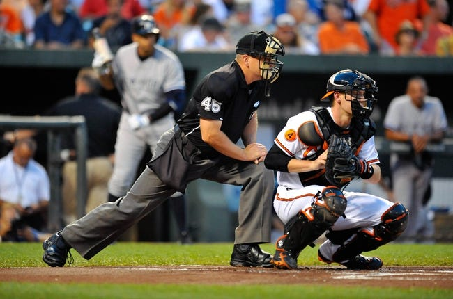 Sep 11, 2013; Baltimore, MD, USA; Home plate umpire Jeff Nelson and Baltimore Orioles catcher Matt Wieters (32) during a game against the New York Yankees at Oriole Park at Camden Yards. The Yankees defeated the Orioles 5-4. Mandatory Credit: Joy R. Absalon-USA TODAY Sports