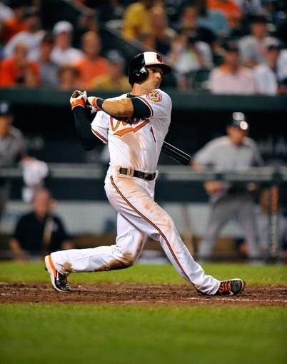 Sep 11, 2013; Baltimore, MD, USA; Baltimore Orioles second baseman Brian Roberts (1) bats in the seventh inning against the New York Yankees at Oriole Park at Camden Yards. The Yankees defeated the Orioles 5-4. Mandatory Credit: Joy R. Absalon-USA TODAY Sports