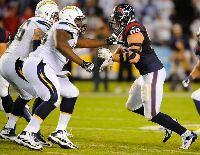 Sep 9, 2013; San Diego, CA, USA; Houston Texans defensive end J.J. Watt (99) lines up against San Diego Chargers offensive tackle D.J. Fluker (76) during the first half at Qualcomm Stadium. Mandatory Credit: Christopher Hanewinckel-USA TODAY Sports