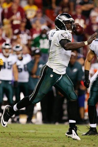 Sep 9, 2013; Landover, MD, USA; Philadelphia Eagles quarterback Michael Vick (7) throws the ball against the Washington Redskins at FedEx Field. Mandatory Credit: Geoff Burke-USA TODAY Sports