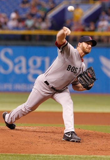 Sep 11, 2013; St. Petersburg, FL, USA; Boston Red Sox starting pitcher Ryan Dempster (46) throws a pitch during the second inning against the Tampa Bay Rays at Tropicana Field. Mandatory Credit: Kim Klement-USA TODAY Sports