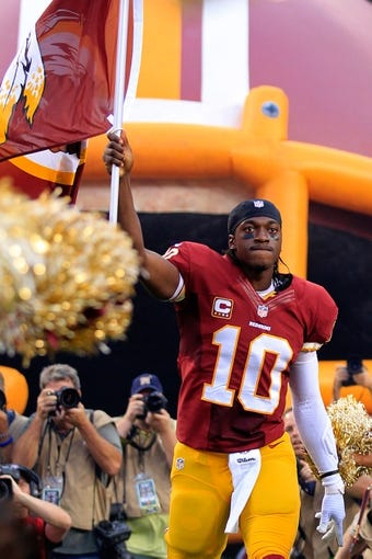 Sep 9, 2013; Landover, MD, USA; Washington Redskins quarterback Robert Griffin III (10) is introduced prior to the Redskins game against the Philadelphia Eagles. Mandatory Credit: Geoff Burke-USA TODAY Sports