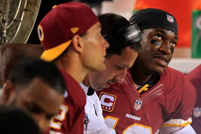 Sep 9, 2013; Landover, MD, USA; Washington Redskins quarterback Robert Griffin III (10) watches from the bench against the Philadelphia Eagles at FedEx Field. Mandatory Credit: Geoff Burke-USA TODAY Sports