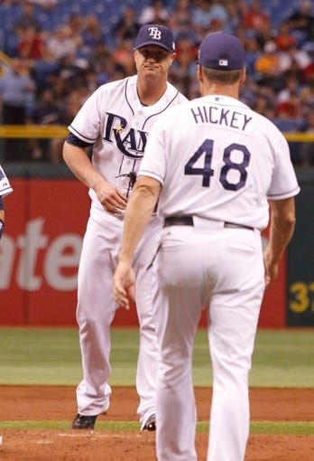 Sep 11, 2013; St. Petersburg, FL, USA; Tampa Bay Rays starting pitcher Alex Cobb (53) reacts as pitching coach Jim Hickey (48) comes out to talk with him against the Boston Red Sox at Tropicana Field. Mandatory Credit: Kim Klement-USA TODAY Sports
