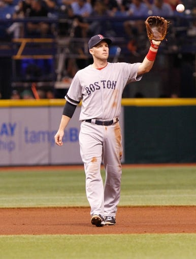Sep 11, 2013; St. Petersburg, FL, USA; Boston Red Sox shortstop Stephen Drew (7) against the Tampa Bay Rays at Tropicana Field. Mandatory Credit: Kim Klement-USA TODAY Sports
