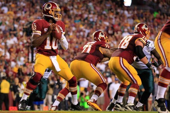 Sep 9, 2013; Landover, MD, USA; Washington Redskins quarterback Robert Griffin III (10) prepares to throw the ball against the Philadelphia Eagles at FedEx Field. Mandatory Credit: Geoff Burke-USA TODAY Sports