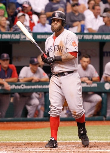 Sep 11, 2013; St. Petersburg, FL, USA; Boston Red Sox first baseman Mike Napoli (12) reacts at bat against the Tampa Bay Rays at Tropicana Field. Mandatory Credit: Kim Klement-USA TODAY Sports