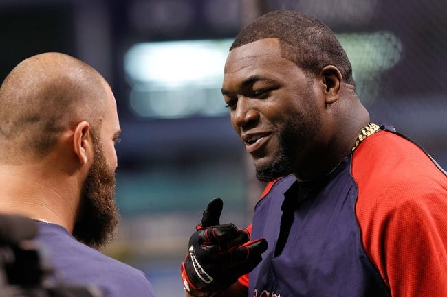 Sep 11, 2013; St. Petersburg, FL, USA; Boston Red Sox designated hitter David Ortiz (34) talks with first baseman Mike Napoli (12) prior to the game against the Tampa Bay Rays at Tropicana Field. Mandatory Credit: Kim Klement-USA TODAY Sports