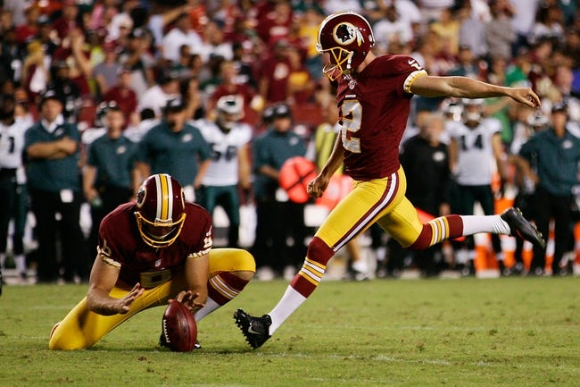 Sep 9, 2013; Landover, MD, USA; Washington Redskins kicker Kai Forbath (2) kicks the ball against the Philadelphia Eagles at FedEx Field. Mandatory Credit: Geoff Burke-USA TODAY Sports