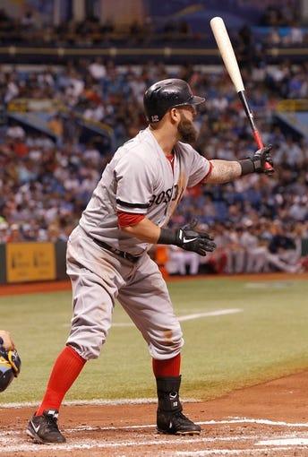 Sep 11, 2013; St. Petersburg, FL, USA; Boston Red Sox first baseman Mike Napoli (12) at bat against the Tampa Bay Rays at Tropicana Field. Mandatory Credit: Kim Klement-USA TODAY Sports