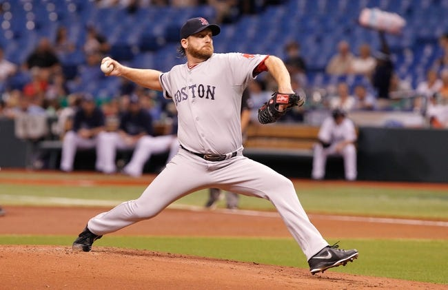 Sep 11, 2013; St. Petersburg, FL, USA; Boston Red Sox starting pitcher Ryan Dempster (46) throws a pitch against the Tampa Bay Rays at Tropicana Field. Mandatory Credit: Kim Klement-USA TODAY Sports