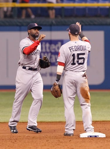 Sep 11, 2013; St. Petersburg, FL, USA; Boston Red Sox left fielder Jackie Bradley Jr. (25) and second baseman Dustin Pedroia (15) congratulate after they beat the Tampa Bay Rays at Tropicana Field. Boston Red Sox defeated the Tampa Bay Rays 7-3. Mandatory Credit: Kim Klement-USA TODAY Sports