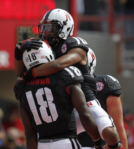 Sep 14, 2013; Lincoln, NE, USA; Nebraska Cornhuskers receiver Quincy Enunwa (18) celebrates his touchdown with receiver Jamal Turner (10) against the UCLA Bruins in the first quarter at Memorial Stadium. Mandatory Credit: Bruce Thorson-USA TODAY Sports