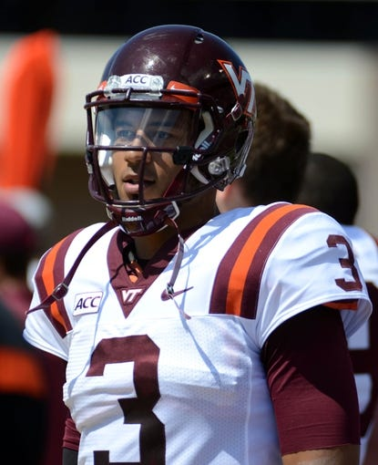 Sep 14, 2013; Greenville, NC, USA;  Virginia Tech Hokies quarterback Logan Thomas (3) watches from the sidelines during a game against the East Carolina Pirates at Dowdy-Ficklen Stadium. Mandatory Credit: Rob Kinnan-USA TODAY Sports