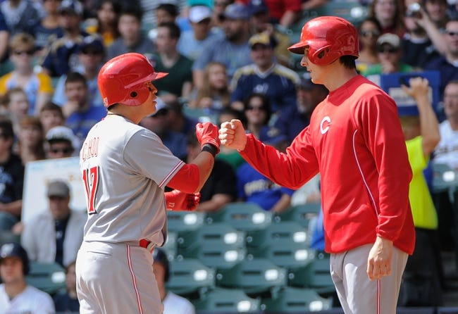 Sep 14, 2013; Milwaukee, WI, USA;  Cincinnati Reds center fielder Shin-Soo Choo (left) is greeted by pitcher Homer Bailey after hitting a 2-run homer in the 2nd inning against the Milwaukee Brewers at Miller Park. Mandatory Credit: Benny Sieu-USA TODAY Sports