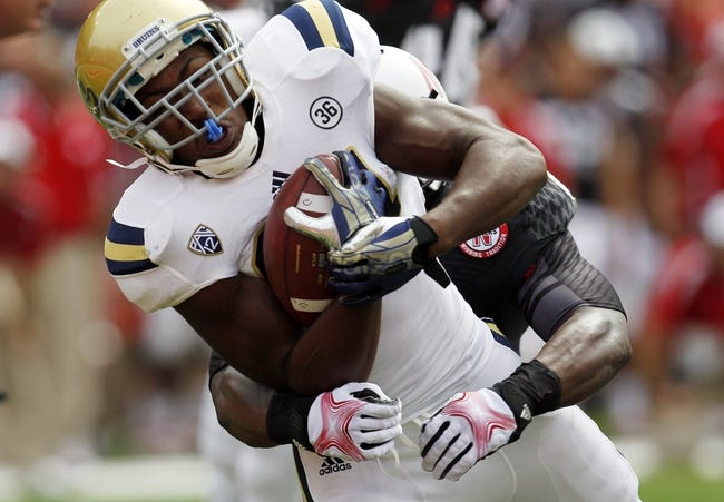 Sep 14, 2013; Lincoln, NE, USA; UCLA Bruins running back Paul Perkins (24) scores a touchdown against the Nebraska Cornhuskers in the second quarter at Memorial Stadium. Mandatory Credit: Bruce Thorson-USA TODAY Sports